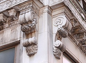 Corbel - Elaborately decorated classical-style stone console corbels supporting balconies on a building in Indianapolis