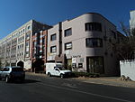 "Apart from minor changes, the buildings have survived substantially intact and are excellent examples of small suburban ""maisonettes"" in the Art Deco Moderne Style. They are the only buildings of their kind in Parktown North."