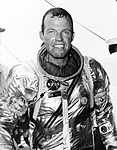 Astronaut L. Gordon Cooper Jr. stands supported by strong hands after climbing out of his spacecraft Faith 7.jpg