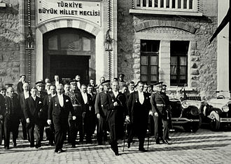 Grand National Assembly of Turkey - President Atatürk and his colleagues leaving the building of the Grand National Assembly of Turkey (today the Republic Museum) after a meeting for the seventh anniversary of the foundation of the Republic of Turkey (1930).