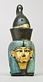 Attachment in the form of the head of a goddess wearing the double crown MET 26.7.1427 front.jpg
