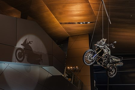 Touratech BMW F800GS motorbike hanging of the BMW Welt roof, Munich, Germany
