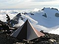 Backpacking alpine mountains peaks tent camping visitor nps photo (22901840336).jpg