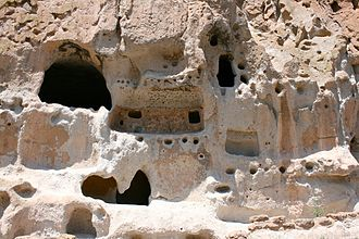 Bandelier National Monument - Detail of natural cavities and architectural carving into the soft tuff.