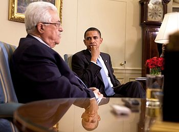 President Barack Obama listens as Palestinian ...
