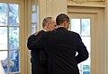 Barack Obama puts his arm around Phil Schiliro, 2009.jpg