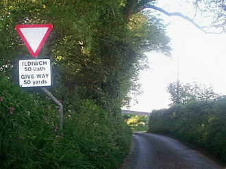 """Yield sign - A bilingual sign in English and Welsh warning of a """"give way"""" junction 50 yards (45 metres) ahead."""