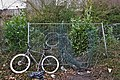 Bicycle standing by an opened barbed fence in Oupeye, Belgium (DSCF3244).jpg