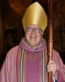 Bishop Binzer vested in rose-colored chasuble, Laetare Sunday, 2012.jpg