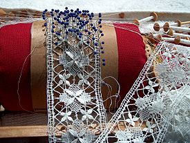 An example of bobbin lace during manufacture.