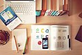Books, pencils, laptop, and iphone on a desk (Unsplash).jpg