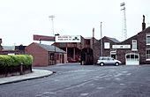 The entrance to the Bootham Crescent association football ground, the entrance sign and a stand visible
