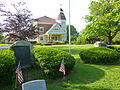 Brewster Council on Aging (old Town Hall) with war memorials in foreground; Brewster, MA.JPG