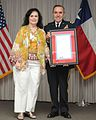 Brigadier General Carlos Garza and his wife Mrs. Yolanda Garza, display his State of Texas Promotion Certificate.jpg