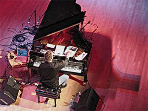 Bruce Hornsby - Hornsby performing a solo piano show June 21, 2005 in North Bethesda, Maryland, audience requests visible across keyboard