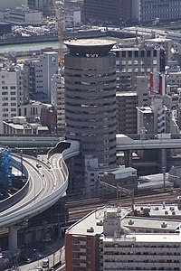 Building penetrated by an expressway 001 OSAKA JPN.jpg