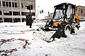 Bulldozer clearing snow in central square MA.jpg