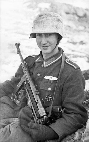 MP 40 - German soldier with an MP 40 on the Eastern Front, 1944.