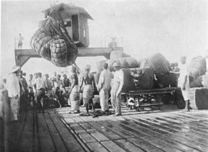 History of Togo - Cotton is loaded onto a ship in the German colony of Togoland, 1885