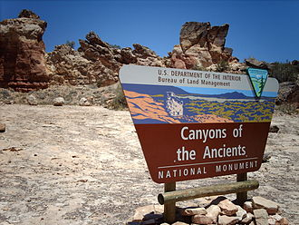 Canyons of the Ancients National Monument - Entrance sign for the monument, with a rock formation