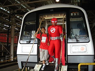 Safety on the Mass Rapid Transit (Singapore) - Captain SMRT demonstrating the use of a refurbished C151's emergency detrainment ramp.