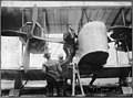 Captain John Alcock stowing provisions aboard Vickers Vimy aircraft before trans-Atlantic flight Jun 14 1919.jpg