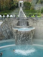 In the Carolus Thermen named for Charlesmagne, the formal cascade gives the water sufficient chance to cool.