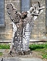 Carved Tree Trunk in Churchyard of St Matthew's, Holbeck - geograph.org.uk - 423578.jpg