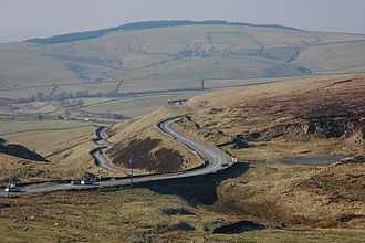 Cat and Fiddle Road - View of a junction on the A537 near the Cat and Fiddle Inn. Macclesfield Forest can be seen on the horizon.