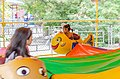 Children in an amusement ride.jpg