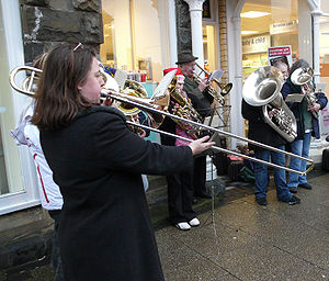 Christmas carol - A brass band playing Christmas carols