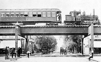 "Lake Street Elevated Railroad - Coal-burning steam locomotive ""Clarence A"" on the Lake Street Elevated Railroad, 1893"