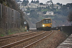 Class 143 on the sea wall at Teignmouth (0158).jpg