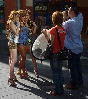 Japanese street fashion - Gyaru being photographed in Ikebukuro in 2009