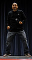 Comedian Edwin San Juan performs a joke about dancing during a visit to Kunsan Air Base, Korea, Nov 081112-F-PH260-263.jpg
