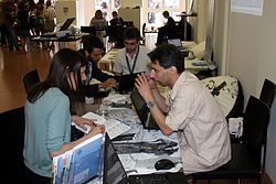 http://commons.wikimedia.org/wiki/File:Communicating_the_museum_conference_-_Wikipedia_booth_%288014%29.jpg