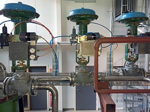 "Control valve - Air-actuated control valves each with a 4-20 mA ""I to P"" converter integral to a valve positioner. In this example each positioner is comparing the valve stem travel against control signal, and applying any correction."