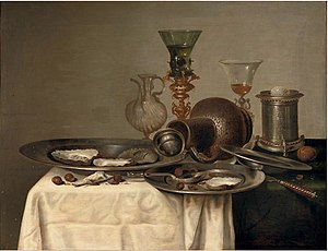 Cornelis Mahu - Oysters and hazelnuts on pewter dishes on a partly draped table
