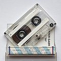 Counterfeit prerecorded cassette in a counterfeit Maxell shell 02.jpg