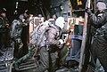 Crewmen push supplies out of a C-141B Starlifter aircraft as an airdrop is made over McMurdo Station, Antarctica, during Operation DEEP FREEZE - DPLA - 6e91cbd29a8cd6b447856c57b35d8583.jpeg