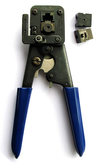 Modular connector - A modular plug crimping tool with exchangeable crimping dies.