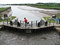 Cyclist wheels across the south Turf Lock gates - geograph.org.uk - 1285751.jpg