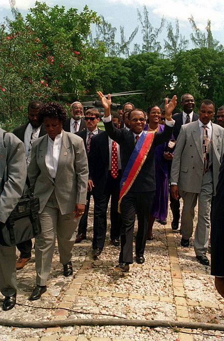 President Jean-Bertrand Aristide returns triumphantly to the National Palace at Port-au-Prince, Haiti in 1994 DD-SD-99-03743.jpg
