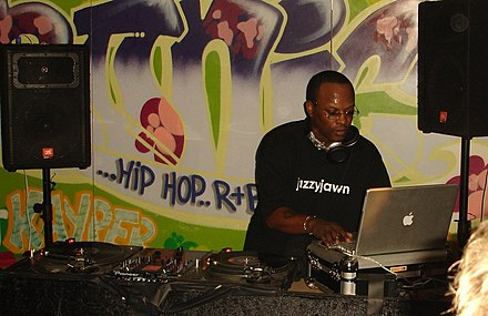DJ Jazzy Jeff, who is also a record producer, manipulating a record turntable in England in 2005. DJ Jazzy Jeff.jpg