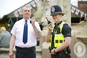Shoplifting - A British store owner using a two-way radio to remain in contact with police, an approach that law enforcement officers hope will reduce shoplifting.