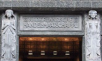 "Netherlands Trading Society - ""Nederlandsche Handel-Maatschappij"" above the entrance to the Amsterdam Archives at the De Bazel building, built as NHM's headquarters"