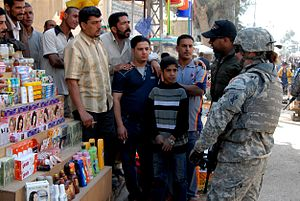 Iraq War order of battle, 2009 - A U.S. Army soldier from the 172nd Infantry Brigade with Iraqi civilians in March 2009.