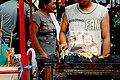 Dinagyang 2009 man grilling meat.jpg