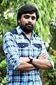 Director M Sasikumar at the Thalaimuraigal Team Press Meet showing their National Award for 2013.jpg