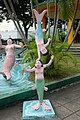 Doing handstand on fellow mermaid, Haw Par Villa (14791572084).jpg